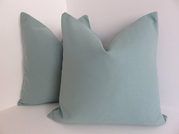 Solid teal pillow