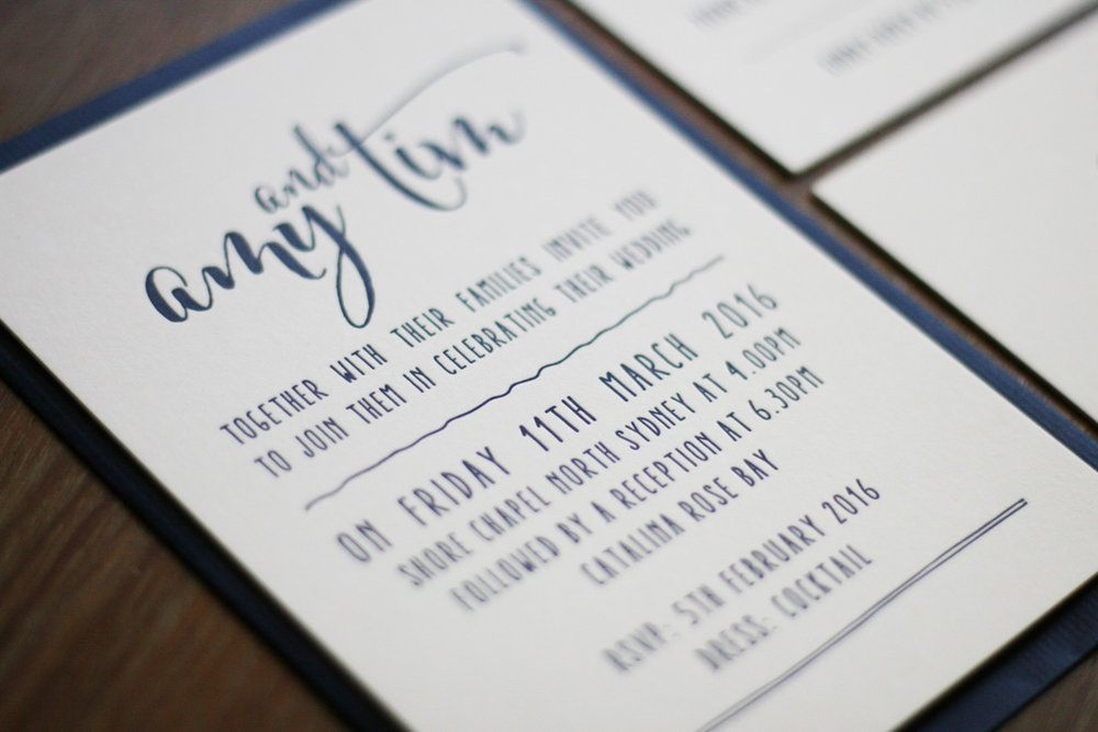 Navy and white wedding invitation script calligraphy letterpress