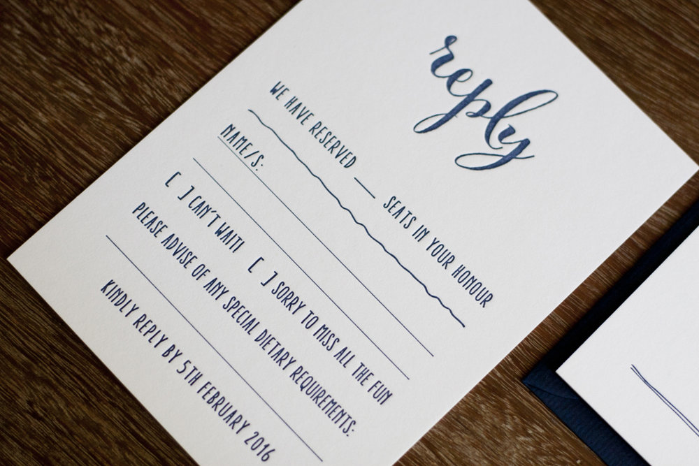 Navy and white wedding rsvp card script calligraphy letterpress