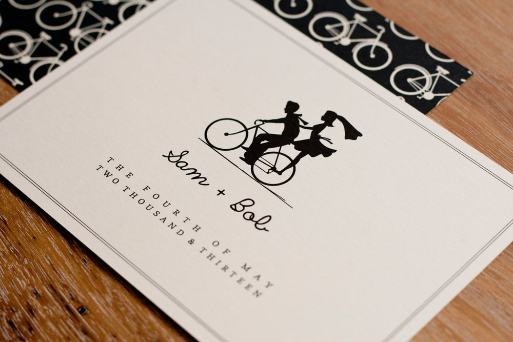 Bride and groom on a bicycle wedding invitation