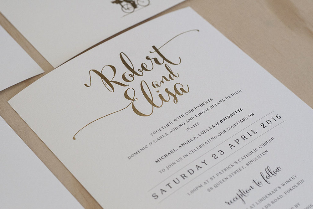 Formal script calligraphy wedding invitation with gold foil