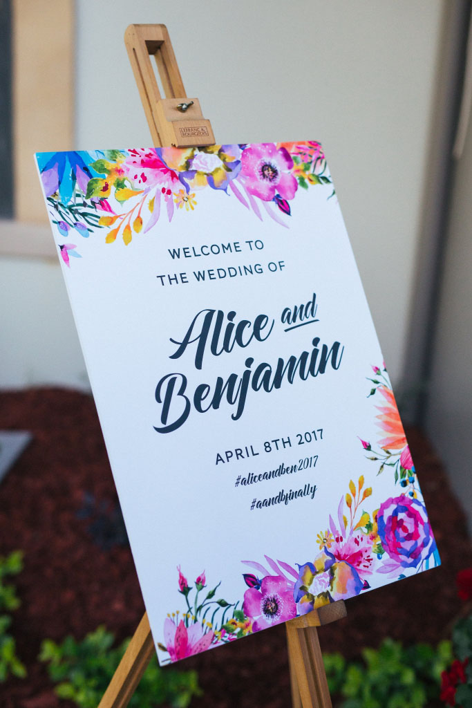 Blooms Floral Spring Wedding Welcome Poster on an easel