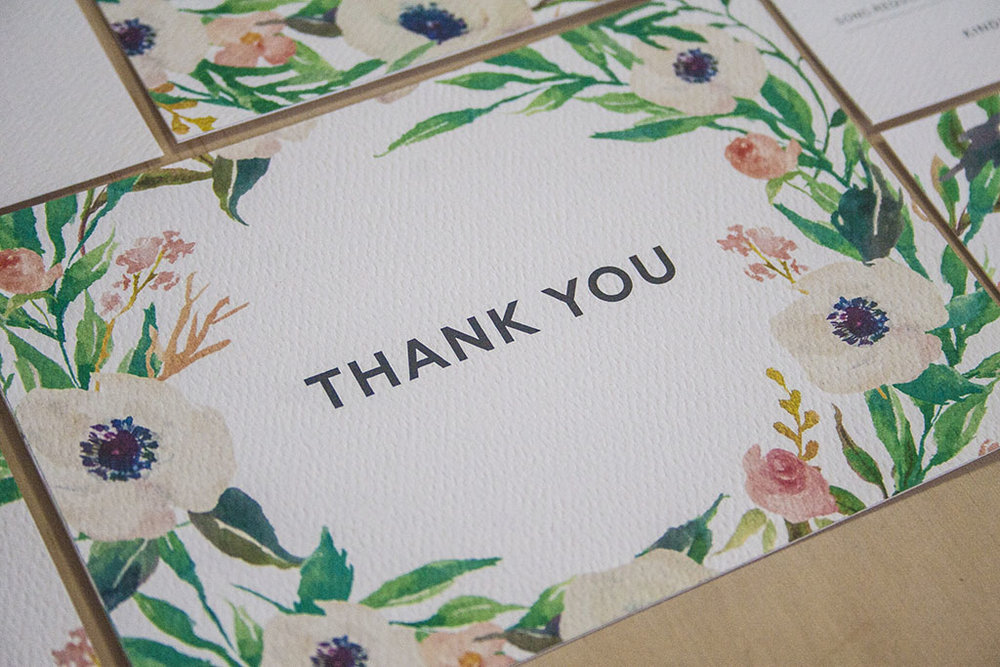 Invitation thank you cards with white flowers and greenery