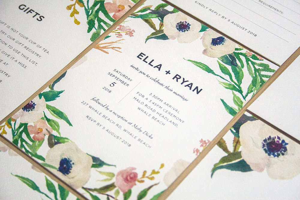 Invitation with white flowers and greenery
