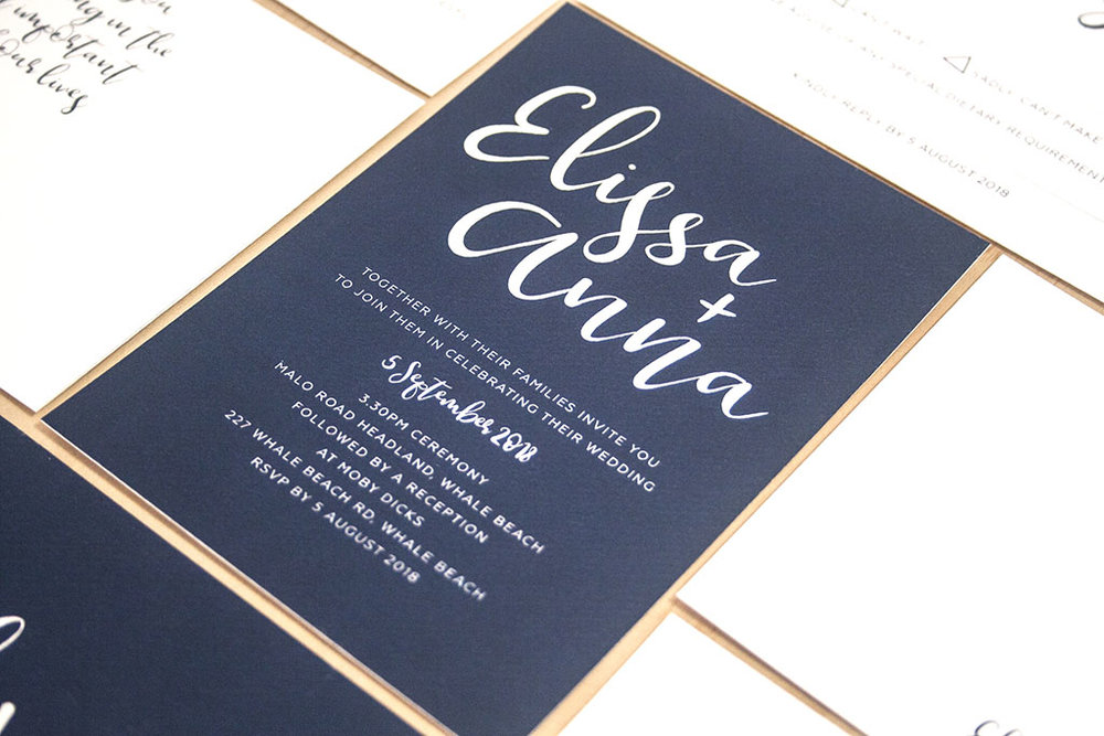 Navy Wedding Invitation with ribbon calligraphy and white envelopes