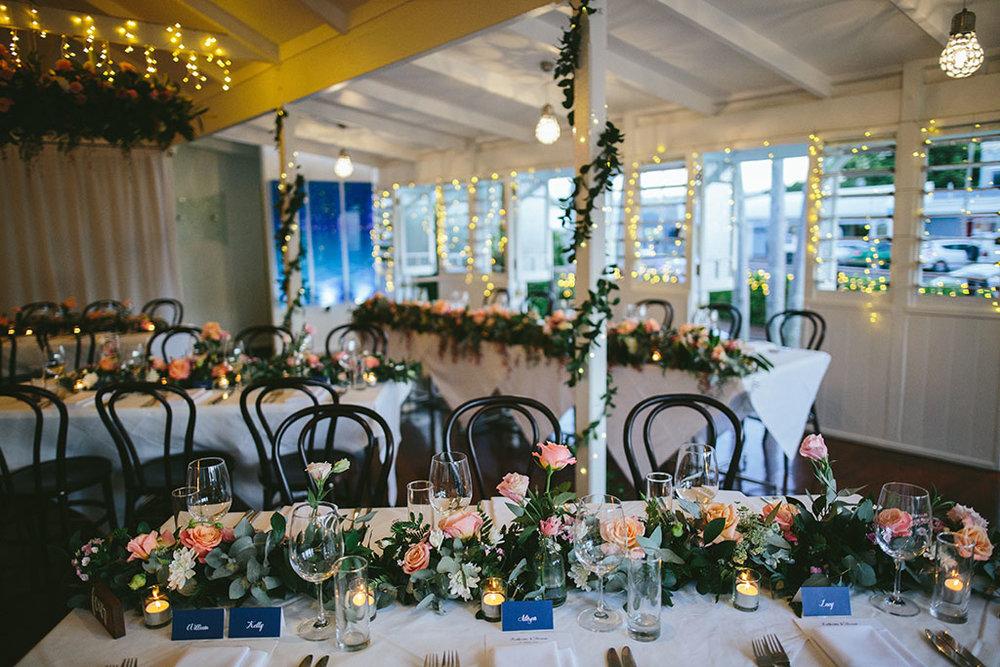 Wedding at Salsa Restaurant in Port Douglas Floral arrangements and fairy lights