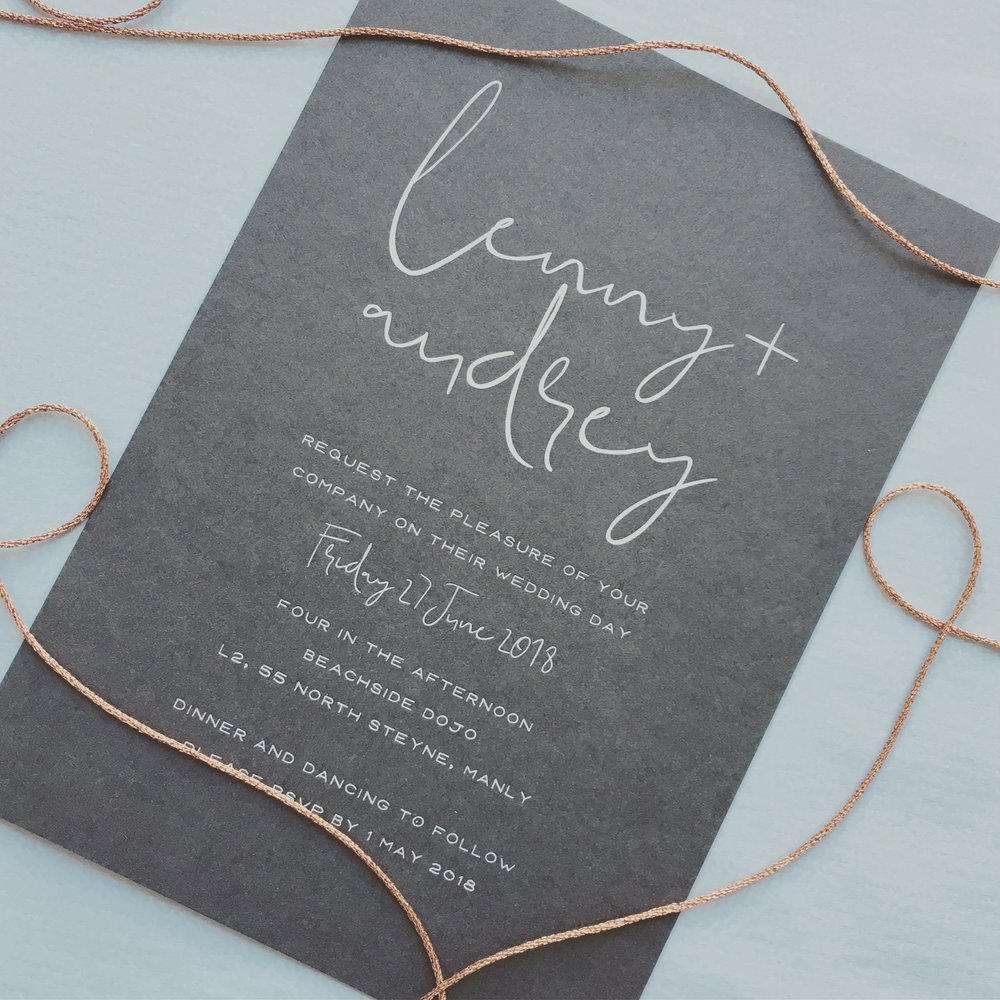 White ink printed on dark grey card wedding invitation
