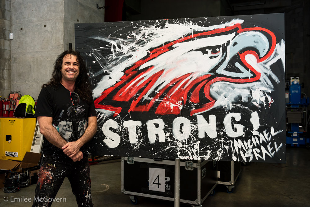 Artist Michael Israel paints live at the Parkland Strong benefit concert, that was held to raise money for Marjory Stoneman Douglas victim familes, and survivors. His painting raised 3,000 dollars, and will be displayed at Majory Stoneman Douglas.