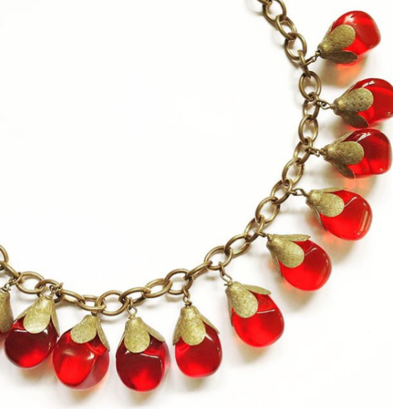 A gorgeous 1930s, red glass bead and brass link necklace. In excellent condition. $189