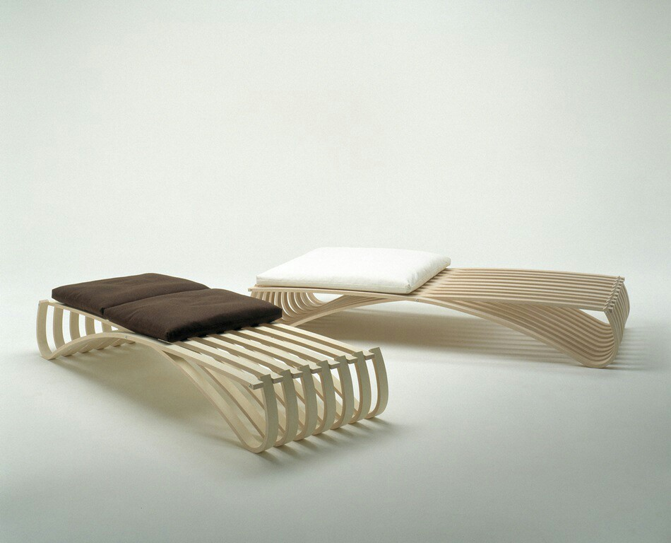 A Danish design and elegant wood daybed with custom cushions, by architect Mads Emil Garde