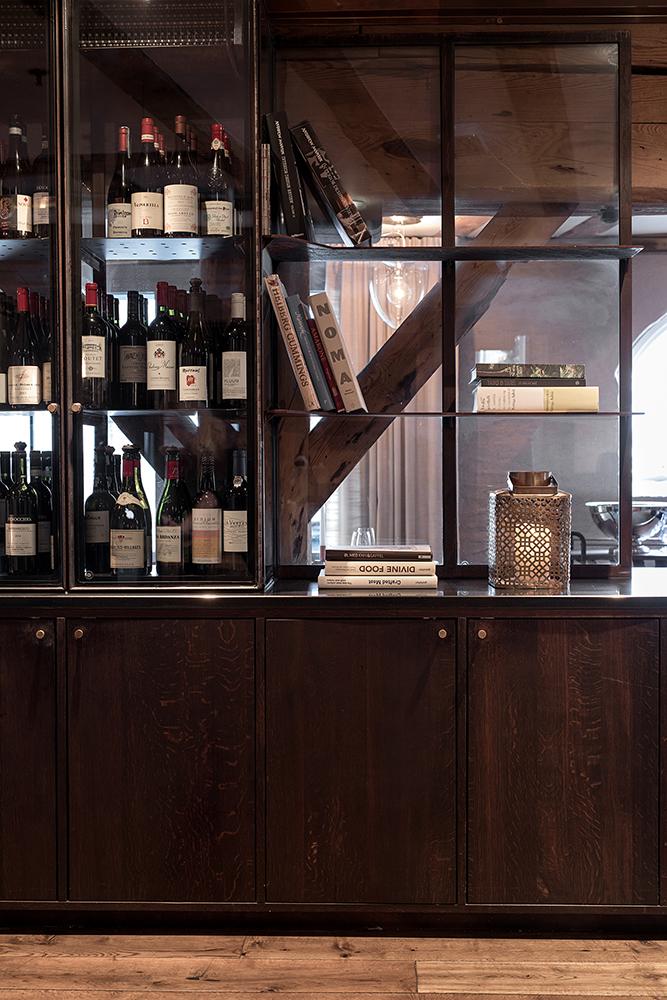 Hotel Brosundet Restaurant Ålesund Norway, raw dark wood and glass cabinets , interior design by GARDE. Mads Emil Garde