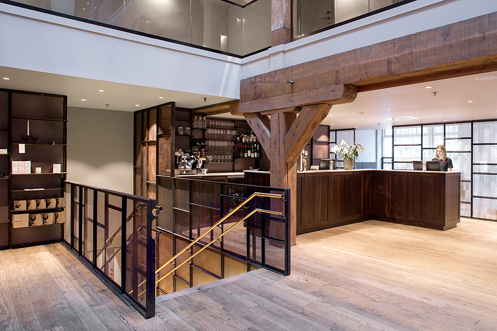 Hotel Brosundet Ålesund Norway, modern and  Minimalistic  Reception and bar in wood and brass by GARDE. Mads Emil Garde