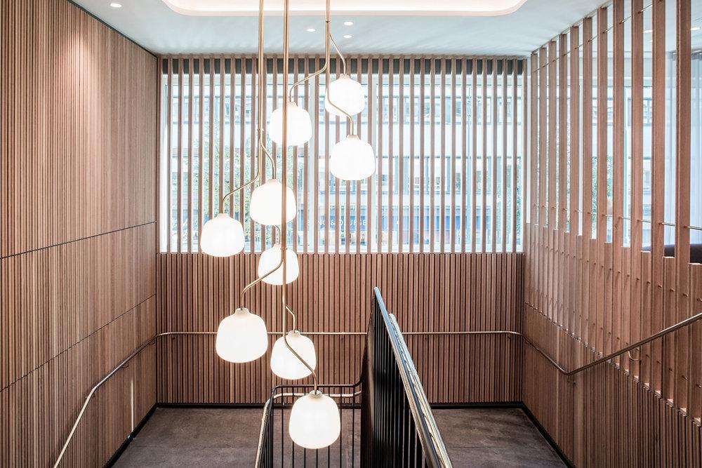 Restaurant Tivander architect drawn staircase, scandinavian interior design and brass light chandelier