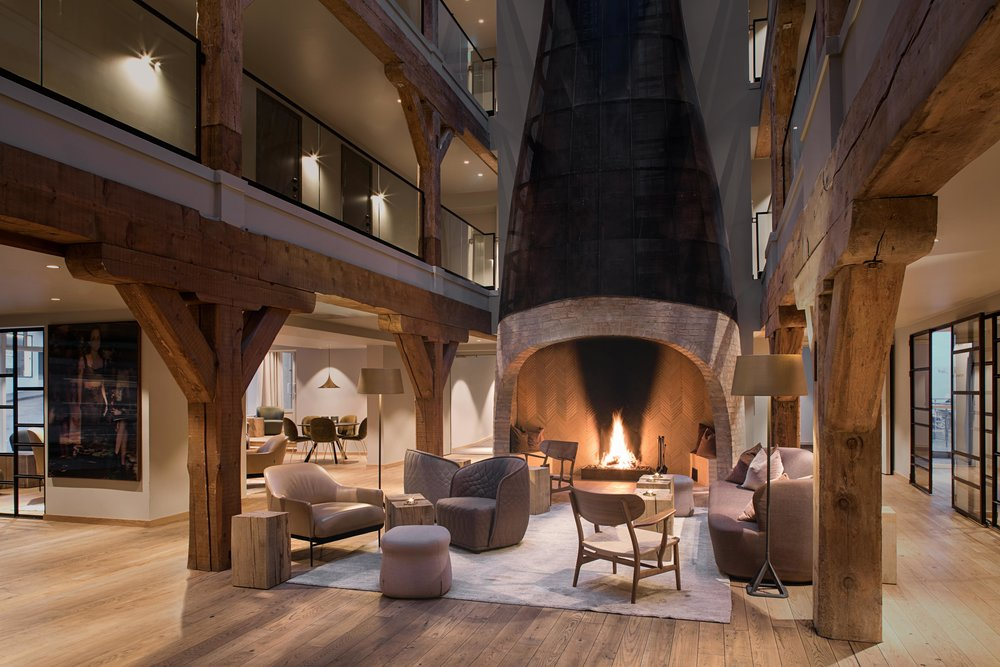 Hotel Brosundet Ålesund Norway, lobby with architect drawn fireplace by GARDE. Mads Emil Garde