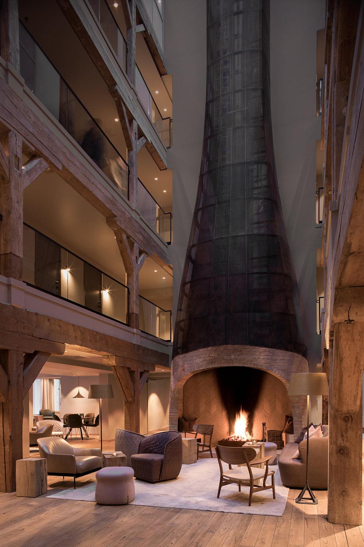 Hotel Brosundet Ålesund Norway, beautiful Scandinavian Fireplace, brick and herringbone wood by GARDE. Mads Emil Garde