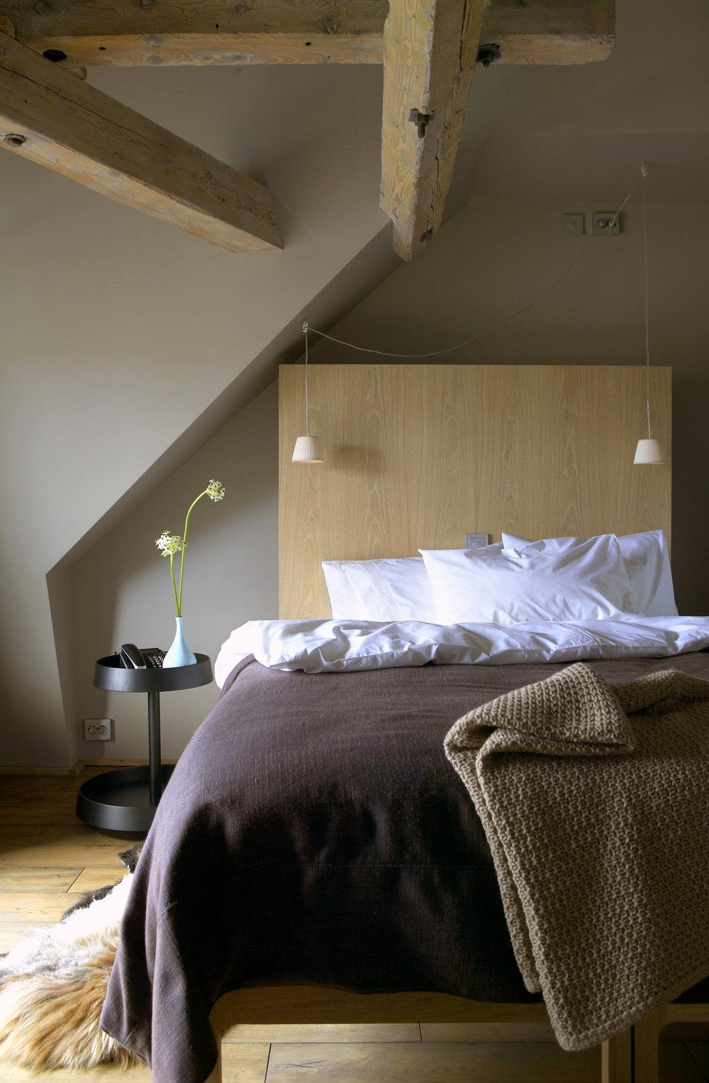 Hotel Brosundet Ålesund Norway, cosy hotel room with raw oak wood, interior design by GARDE. Mads Emil Garde