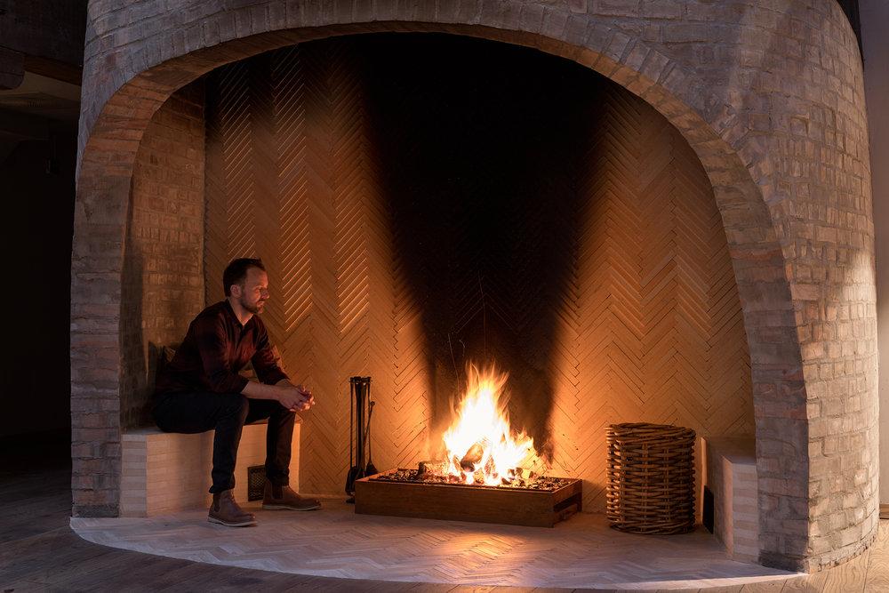 Hotel Brosundet Ålesund Norway, Scandinavian Fireplace, brick and herringbone wood by GARDE. Mads Emil Garde
