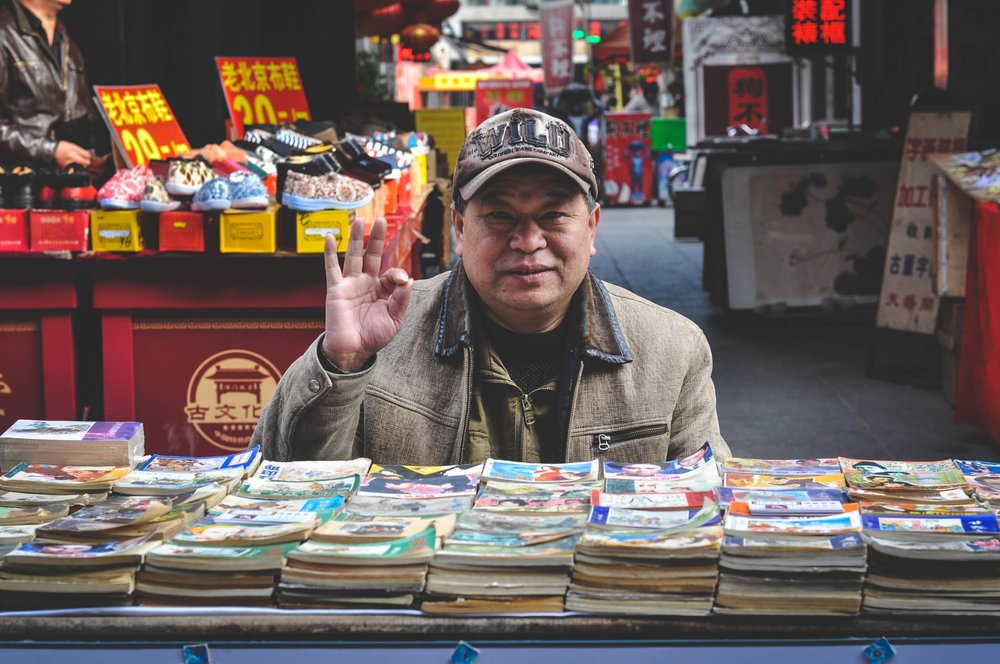 Chinese Man selling books.jpeg