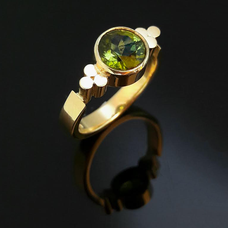 Green Tourmaline 18ct yellow Gold Triscel Ring.jpg