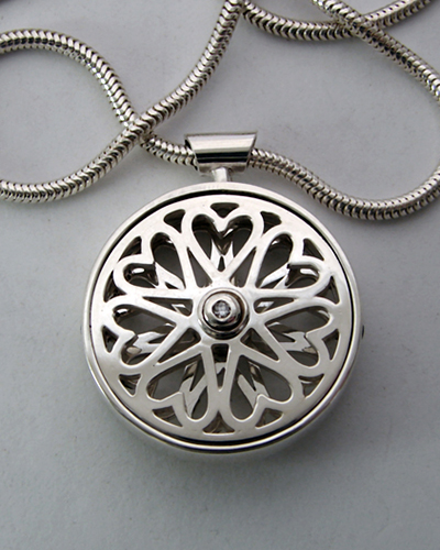 Hearts go round and round. Sterling Silver, Diamond.jpg