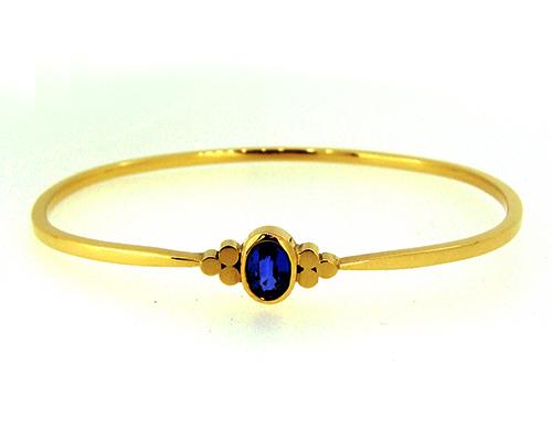Ceylon Blue Sapphire 18ct Yellow Gold Bangle Triskle Design.jpg