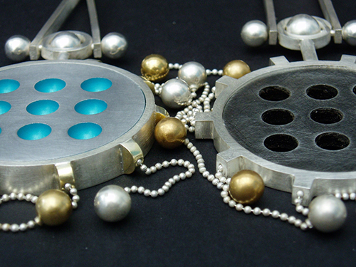 2 swingy x and o pendents Web.jpg