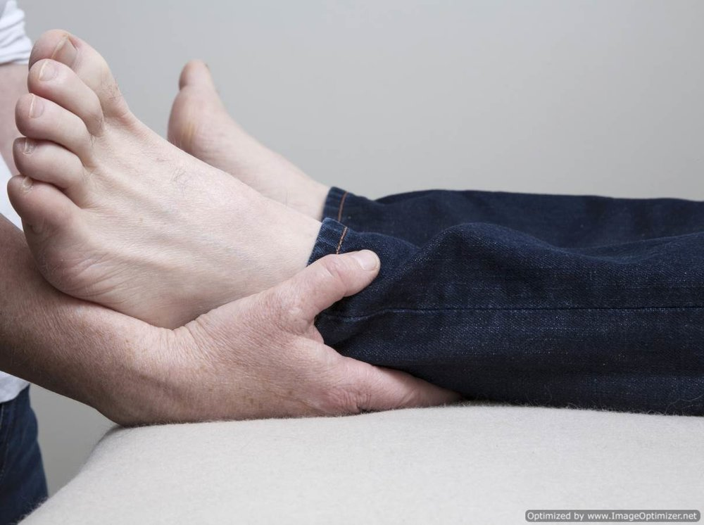 Light touch contact is made on the feet to begin the treatment - every approach to make contact with the body is made with soft and gentle consideration...
