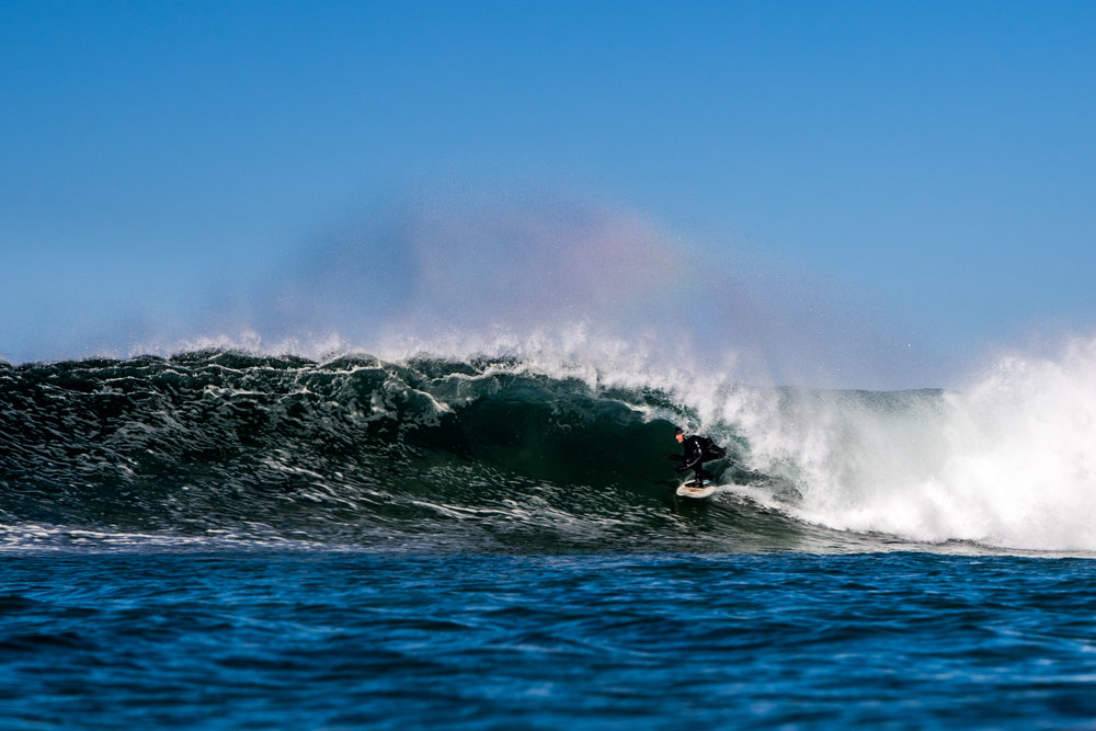 The ocean provides us with recreational activities like surfing, scuba diving and snorkling, but human activities are destroying it at an alarmingly high rate. Time to give back, says Simen Knudsen, leader of the environment collective Nordic Ocean Watch, here captured riding a wave. Photo: Hallvard Kolltveit