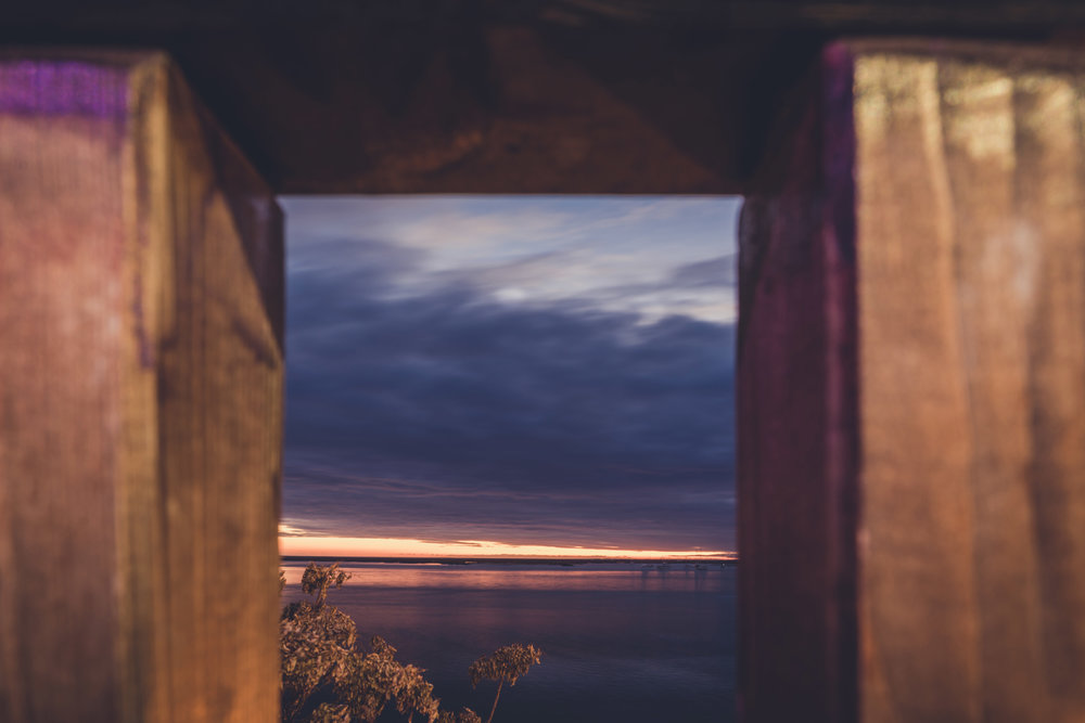 sunset through the gap. faro sunset. faro in the algarve. old town faro.jpg