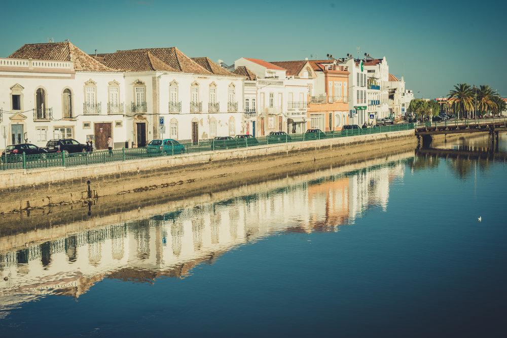 Tavira Roman Bridge. Old town Tavira. Street scene in Tavira. Algarve. River reflections.JPG