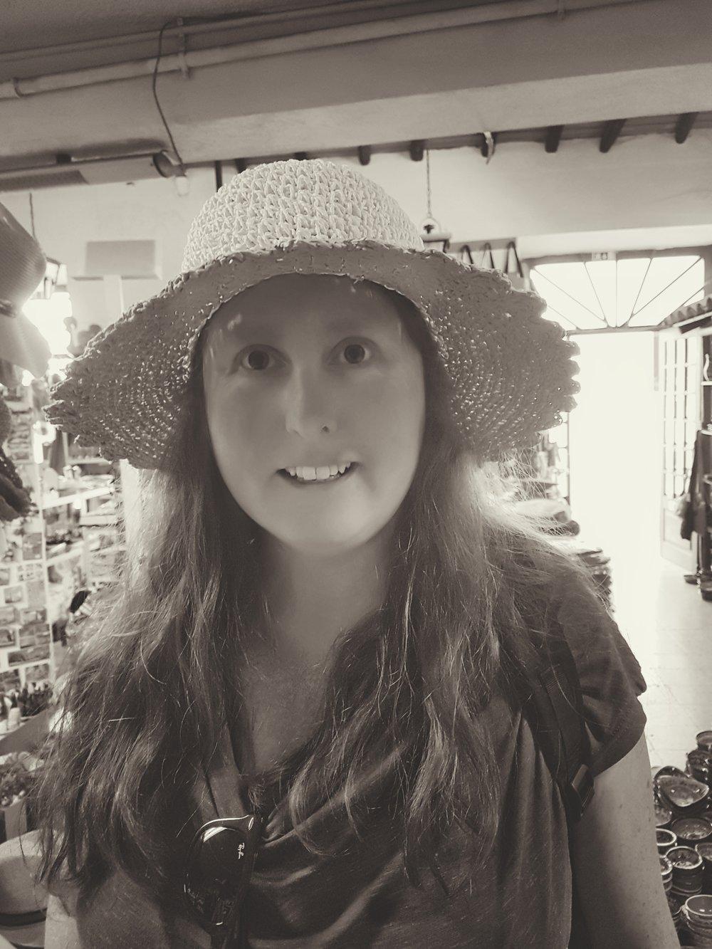 trying on a hat in Loule. Loule in the Algarve. Old town loule..jpg