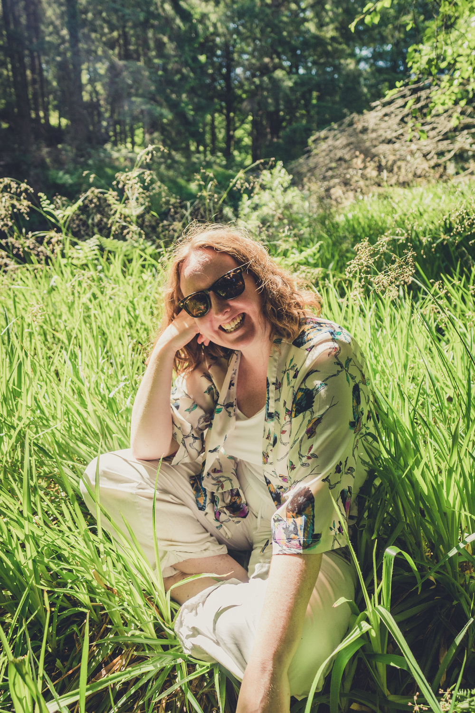 Vale of Clara. Walking in Wicklow. The garden of Ireland. Wicklow. Clara Vale. Ferns. Ireland. Flowers. water. Girl in grass. Happy smile.jpg