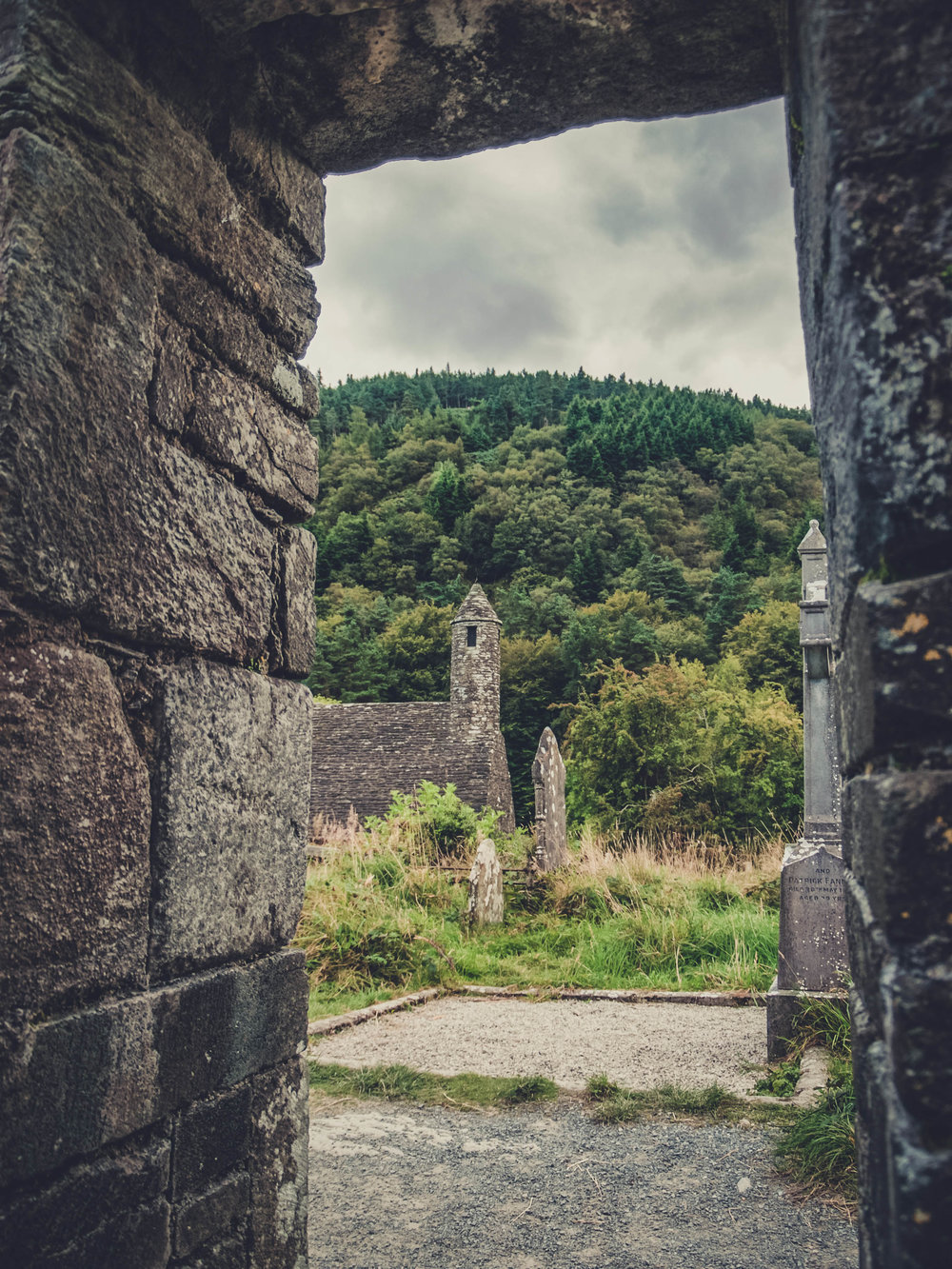 glendalough. irish history. county wicklow. round tower. hill walknig. hiking. grave yard. wildlife. tombstones. lakes. blue sky. frame.jpg