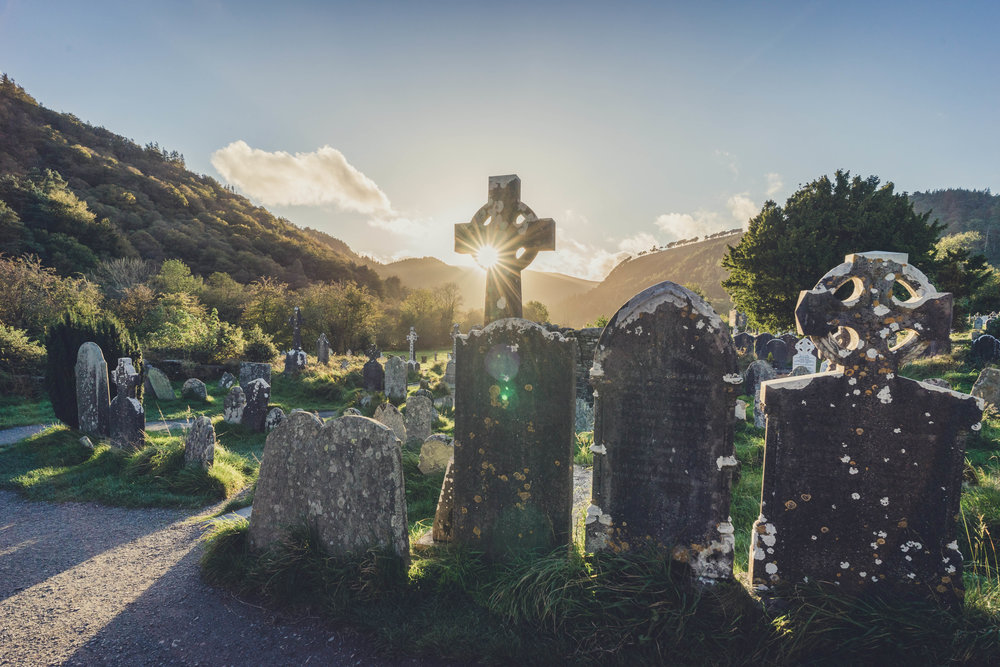 glendalough. irish history. county wicklow. round tower. hill walknig. hiking. grave yard. wildlife. tombstones. lakes. blue sky. sunlight peering through.jpg