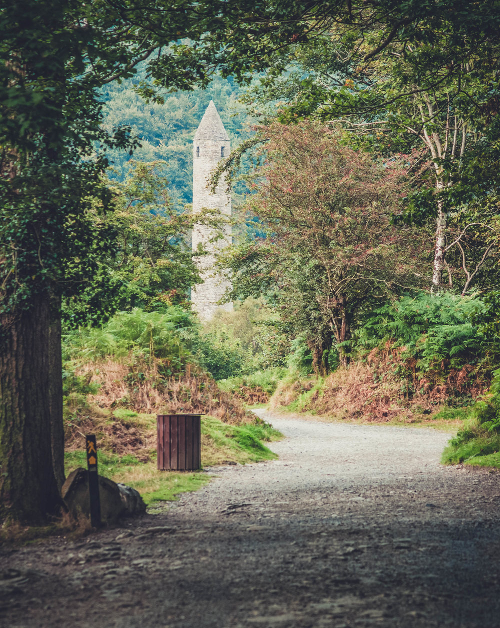 glendalough. irish history. county wicklow. round tower. hill walknig. hiking. grave yard. wildlife. tombstones. lakes. blue sky. through the trees.jpg