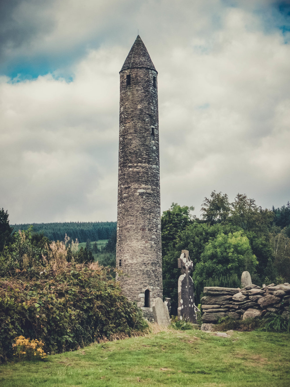 glendalough. irish history. county wicklow. round tower. hill walknig. hiking. grave yard. wildlife. tombstones. lakes. blue sky. tower.jpg