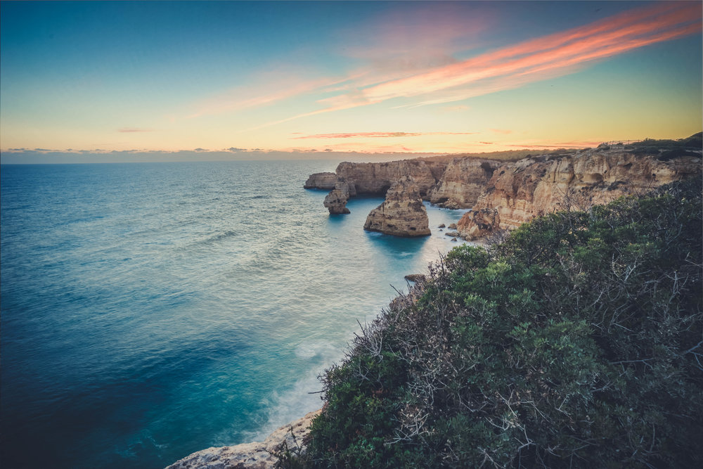 Marinha Beach. Seven Hanging Valleys Walk. portugal. algarve. beach. cliffs. tavel. caves. sea caves. standing on the rocks. the end of the day and suns.jpg