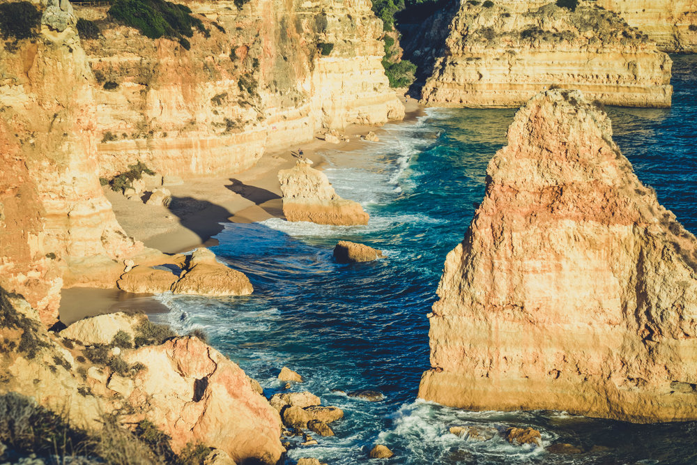 Marinha Beach. Seven Hanging Valleys Walk. portugal. algarve. beach. cliffs. tavel. caves. looking down to the beach through the seastacks.jpg