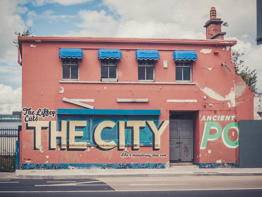 Dublin. Dublin city. street photography. ireland. travel. travel photography. photowalk. walking. people. street. art. on the street. run down building..jpg