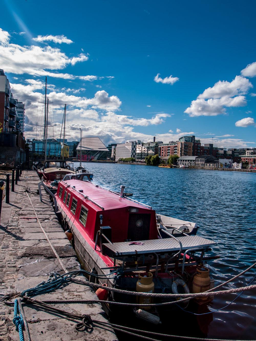 Dublin. Dublin city. street photography. ireland. travel. travel photography. photowalk. walking. people. street. art. on the street. river boat. liffey.jpg
