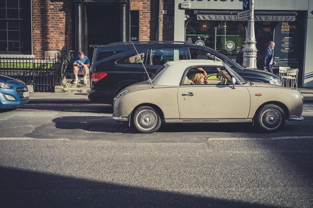 Dublin. Dublin city. street photography. ireland. travel. travel photography. photowalk. walking. people. street. art. on the street. sitting in the car.jpg