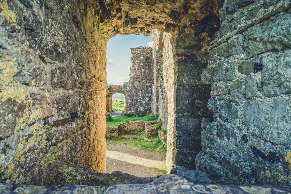 Ireland. Castle. Old castle. irish history. history. Rock of Dunamase. blue sky. rock. pathway. adventure. travel. irish counrty. castle arch. castle door.jpg
