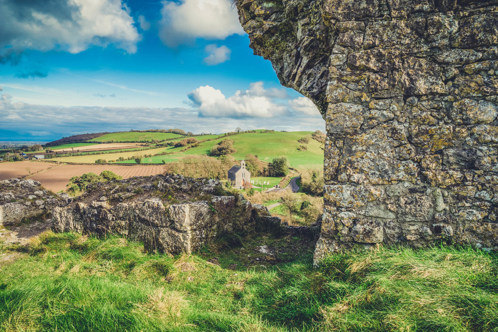 Ireland. Castle. Old castle. irish history. history. Rock of Dunamase. blue sky. rock. pathway. adventure. travel. irish counrty. green fields. castle walls.jpg