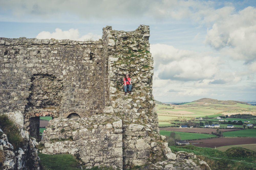 Ireland. Castle. Old castle. irish history. history. Rock of Dunamase. blue sky. rock. pathway. adventure. travel. sitting on the castle.jpg