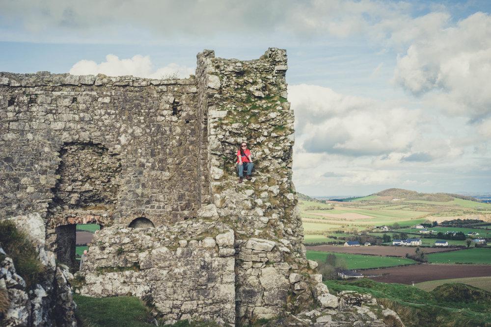 Ireland. Castle. Old castle. irish history. history. Rock of Dunamase. blue sky. rock. pathway. adventure. travel. sitting on the castle.jpg