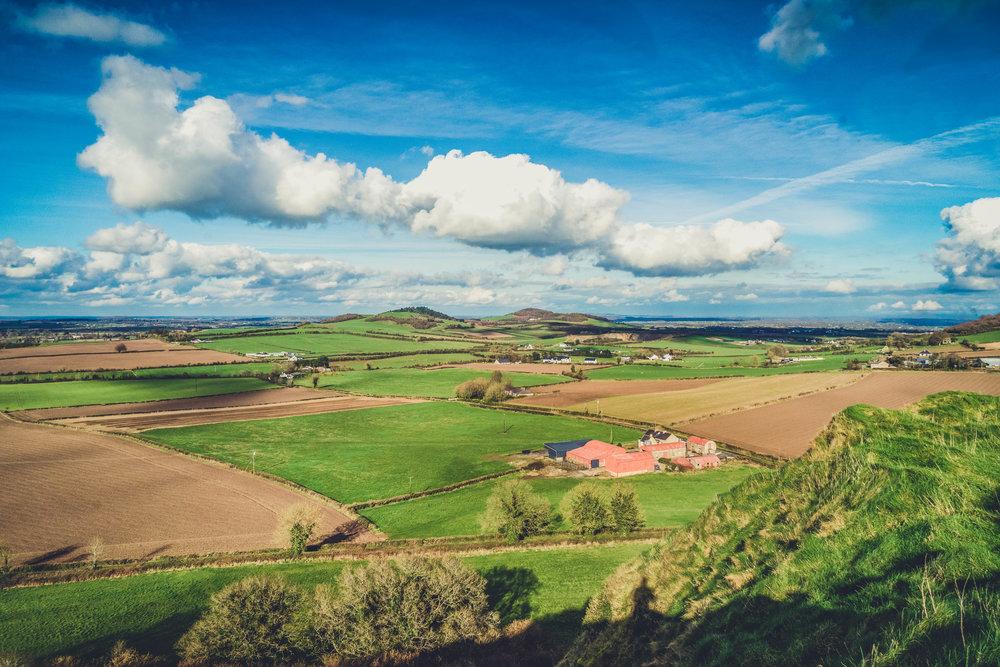 Ireland. Castle. Old castle. irish history. history. Rock of Dunamase. blue sky. rock. pathway. adventure. travel. irish counrty. green fields. farm land.jpg