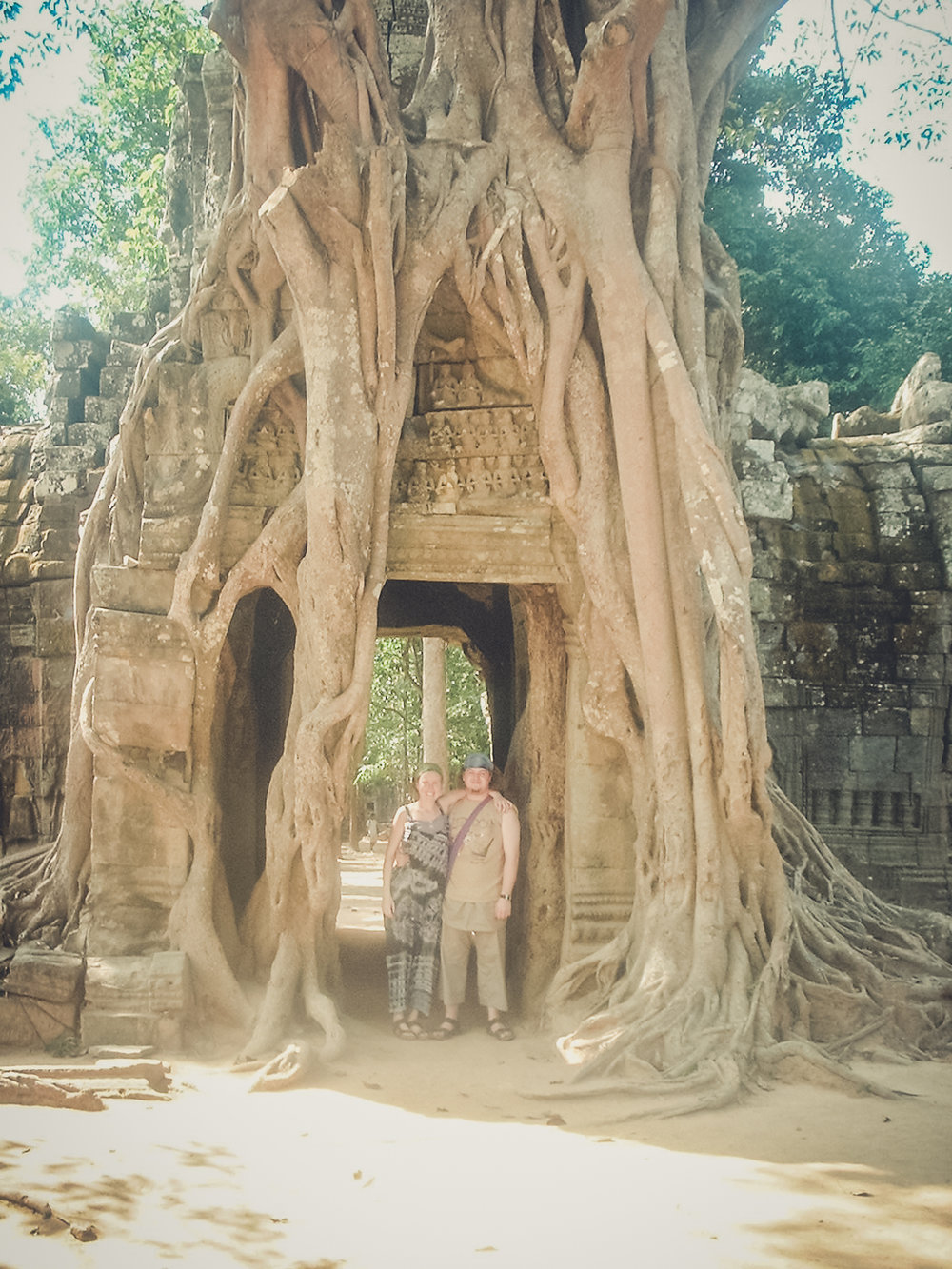 backpacking. south east asia. travel. young. thailand. cambodia. malaysia. couple. trip. tree arch.jpg