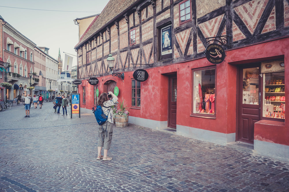 malmo. sweden. travel. scandinavia. history. viking. city. old. travel blog. palace. old town square palace.. orla taking a picture.jpg