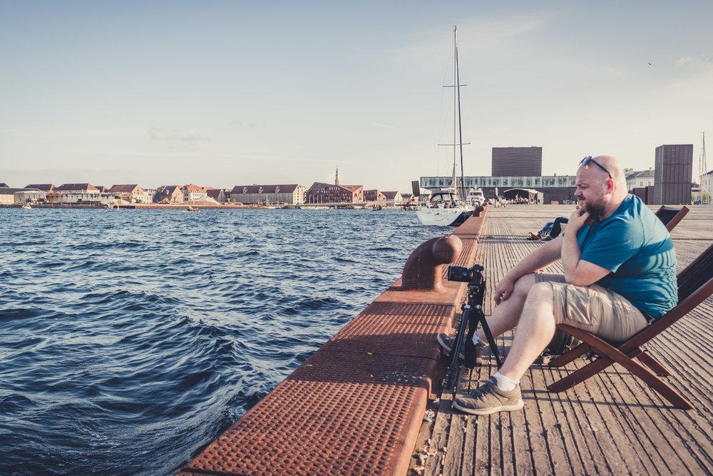 copenhagen. denmark. travel. adventure. europe. scandinavia. history. travelblog. taking a picture of the river. sitting on the docks.jpg