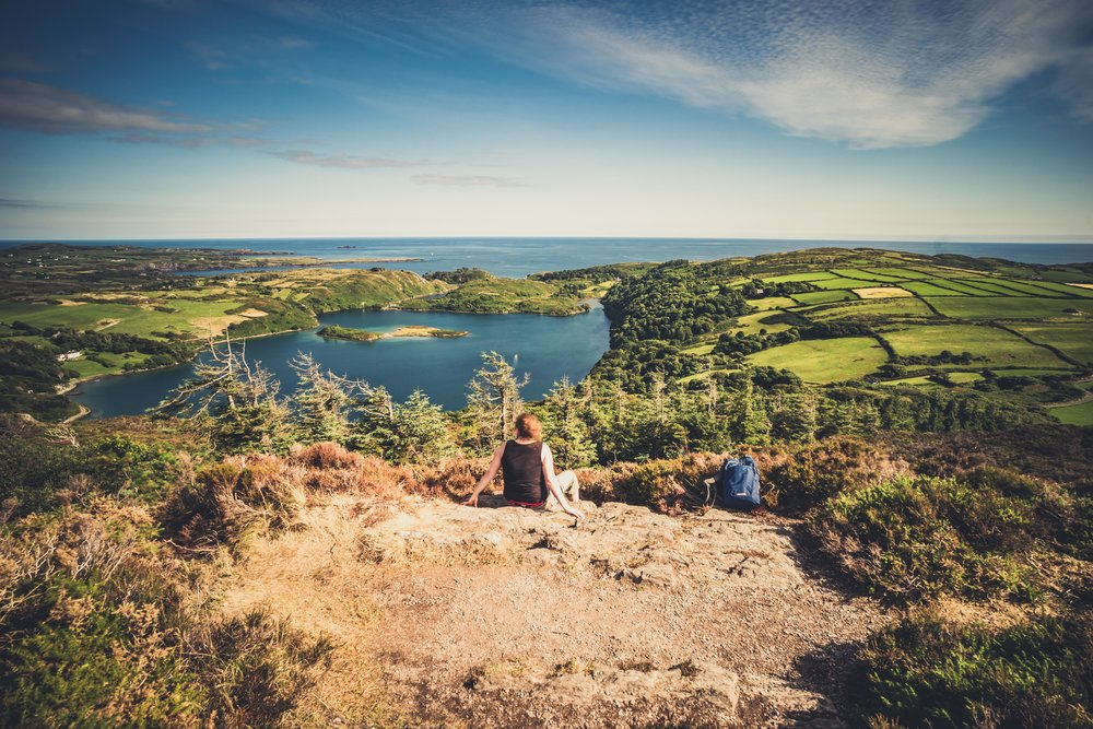 county cork. cork. ireland. irish. history. city. house sitting. old. travel. travel photography. travel photographer. lough hyne. hiking. outdoor. adventure. hiking. resting at the top.jpg
